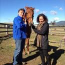 Chris and Jane sharing the love with their mare Legally Bay...