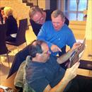 Afternoon at the Hawkes' - Kevin , John and Michael study the form guide